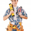 Beautiful female worker holding tools — Stock Photo