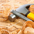 Stock Photo: Claw hammer and carpenter chisel with wooden chips