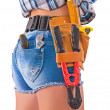 Female worker. Tools in back pockets and tool belt. Close up. — Stock Photo #36602687