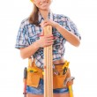 Half length portrait of happy female construction worker with wooden planks and tool belt — Stock Photo #36602823