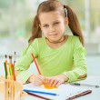 Schoolgirl do homework at the table — Stock Photo