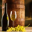 Vine composition old barrel with wineglass bottle — Stock Photo