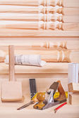 Woodworking tools on steps of wooden lader — Stock Photo