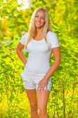 Young female wearing white sports clothes — Stockfoto