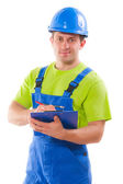 Young worker writing in clipboard — Stock Photo