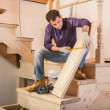 Carpenter is measuring step — Stock Photo