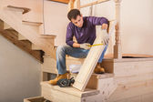 Carpenter is measuring step — Stockfoto