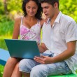 Couple with laptop — Stock Photo #40000225