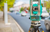 Theodolite on street of small town — Stock Photo