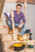 Young carpenter with tools — Stock Photo