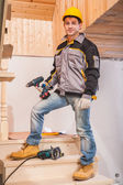 Contractor  holding cordless drill — Stock Photo