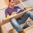 Stock Photo: Worker sitting with wooden board