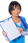 Asian female doctor showind clipboard with blank white sheet — Stock Photo