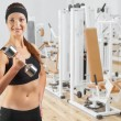 Beautiful  woman   holding dumbbell — Stock Photo #44485801