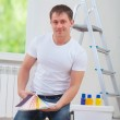 Handsome young manwith paint tools — Stock Photo #44485859