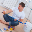 Youg painter sitting on floor — Stock Photo #44485959