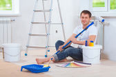 A handsome painter sitting on floor — Stock Photo