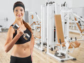 Beautiful  woman   holding dumbbell — Stock Photo