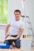 Handsome young manwith paint tools — Stock Photo