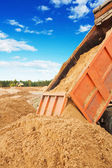Road works tipper unloadding sand — Stock Photo