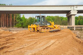 Bulldozer near bridge — Stock Photo