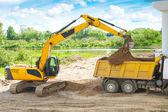 Process of loading sand — Stock Photo