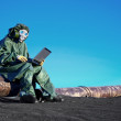 Scientist with a laptop on chemically contaminated area — Stock Photo #11797569