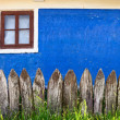Fence near the old village house — Stock Photo
