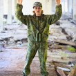 Royalty-Free Stock Photo: The woman in military uniform surrenders