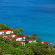 Beautiful small houses near the tropical ocean — Stock Photo