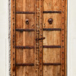 Stock Photo: An old dilapidated wooden door