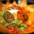 Nachos with salsa verde and olives - Foto Stock