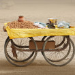 Stock Photo: Counter to sell roasted peanuts. India.