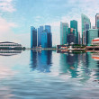 Stock Photo: Singapore skyline with skyscrapers and reflection in water