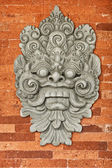 Stone bas-relief on the brick wall. Indonesia, Bali. — Stock Photo