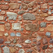Seamless natural different size stones wall — Stock Photo