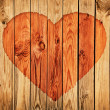 Silhouette of heart on wooden wall — Stock fotografie