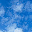Light, transparent cumulus clouds - zenith of sky — Stock Photo #20938737