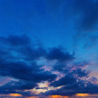 Sunset on deep blue sky. Panorama from several photos. — Stock Photo