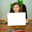Schoolgirl artist with white blank paper sheet — Stock Photo