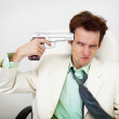 Tattered businessman in white suit with gun — Stock Photo #21374055