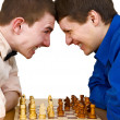 Two aggressive chess opponents under chess board — Stock Photo