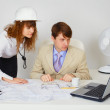 Business construction industry team looking on laptop — Stock Photo