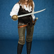 Young womin pirate suit with sabre — Stock Photo #21375685