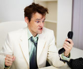 Very angry businessman in office — Stock Photo