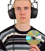 Sad disappointed man with big headphones and CD — Stock Photo