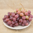 Grape on plate on textile background — Stock Photo #2263051