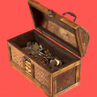 Wooden opening ancient chest with coins — Stock Photo #2264810