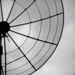 Old parabolic antenna on sky background — Stock Photo