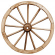 Big vintage rustic wagon wheel — Stock Photo #23069536